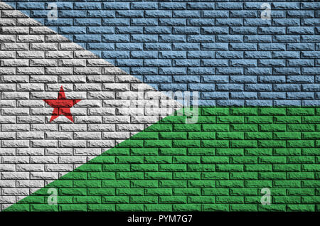 Djibouti flag is painted onto an old brick wall - Stock Photo