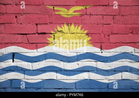 Kiribati flag is painted onto an old brick wall - Stock Photo