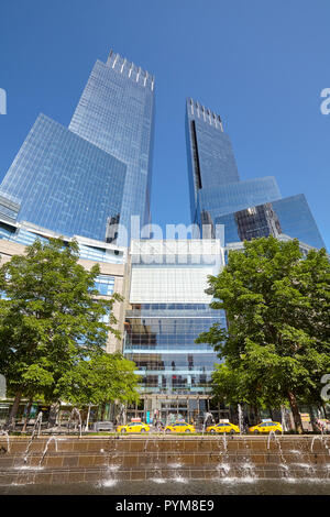 New York City, USA - June 30, 2018: Row of taxis parked in front of the Time Warner Center at Columbus Circle on a sunny summer day. - Stock Photo