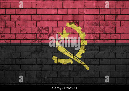 Angola flag is painted onto an old brick wall - Stock Photo