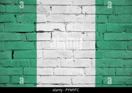 Nigeria flag is painted onto an old brick wall - Stock Photo