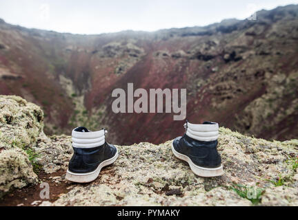 Man shoes on the edge of cliff. Suicide and major depressive disorder concept - Stock Photo