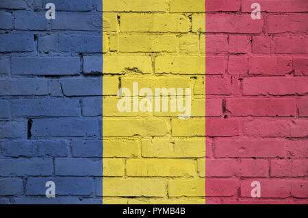 Chad flag is painted onto an old brick wall - Stock Photo