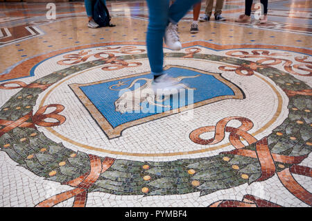 Italy, Lombardy, Milan, Vittorio Emanuele II Gallery, Spinning on Bulls Genitals for Good Luck
