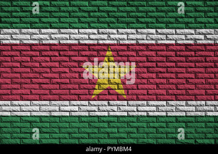 Suriname flag is painted onto an old brick wall - Stock Photo