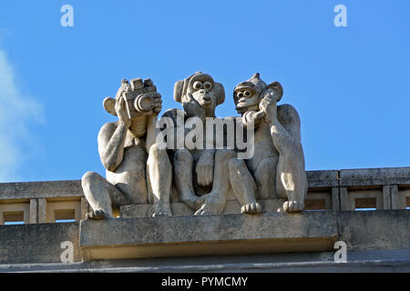 Three Wise Monkeys sculpture on the roof of Waterloo Park Pavilion, Norwich, Norfolk, UK - Stock Photo