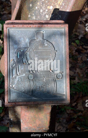 Embossed plaque on mile marker on Marriott's Way long-distance footpath / cycleway between Norwich and Drayton, Norfolk, UK - Stock Photo