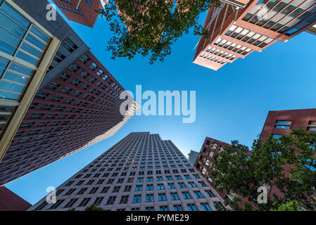 A plane flying over the modern blue cubic buildings located at The Hague city, Netherlands - Stock Photo