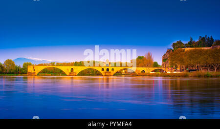 Night view of Pont d'Avignon over river Rhone, France - Stock Photo