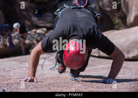 La Pedriza, Madrid, Spain. Aerial view of granite rock climber climbing a granite route. - Stock Photo