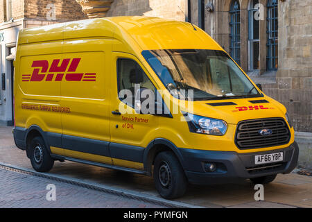 DHL express delivery van on parked the street. UK. - Stock Photo