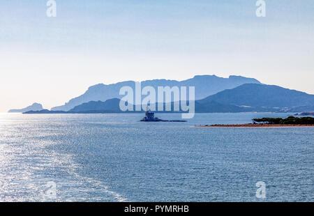 Italy, Sardinia, the beacon of the Olbia harbor - Stock Photo
