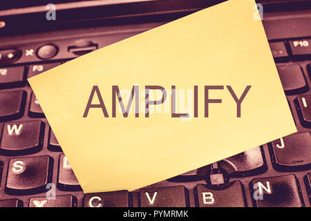 Handwriting text writing Amplify. Concept meaning Make something bigger louder increase the volume using amplifier. - Stock Photo