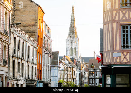 Street view with beautiful old buildings and cathedral tower on the background in Rouen city, the capital of Normandy region in France - Stock Photo