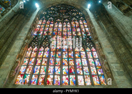 Milan, Italy, The interior of the Duomo Cathedral, the colorful stained glass of the apse - Stock Photo