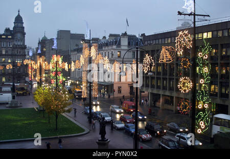 The Xmas lights and decorations, as seen from inside the City Chambers,  light up George Square and the surrounding area in Glasgow. - Stock Photo