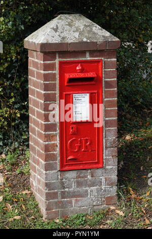 Red Royal Mail Post Office Box, England UK - Stock Photo