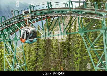 BANFF, AB, CANADA - JUNE 2018: A gondola approaching the summit of Sulphur Mountain in Banff. - Stock Photo