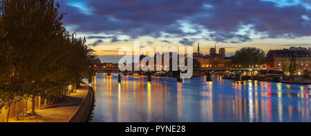 The panoramic view of Paris, Seine river, Arts bridge in the early morning. - Stock Photo