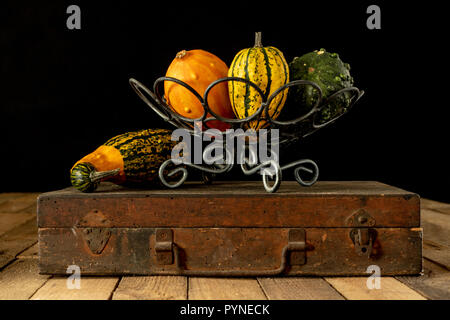 Decorative pumpkin on a white kitchen table. Fruit for halloween for decorations. Autumn background. - Stock Photo