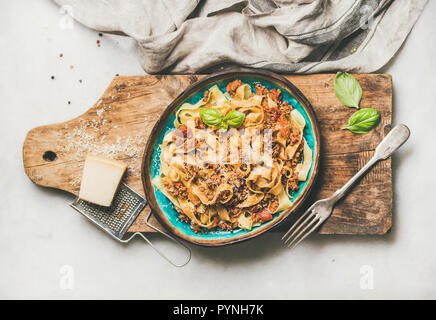 Italian traditional pasta dinner with tagliatelle bolognese, horizontal composition - Stock Photo