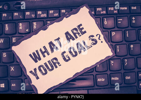 Conceptual hand writing showing What Are Your Goals question. Business photo showcasing ask the Desired End Results to know the plans. - Stock Photo
