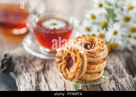 Homemade cookies with Apple jam on a wooden table. Close up - Stock Photo