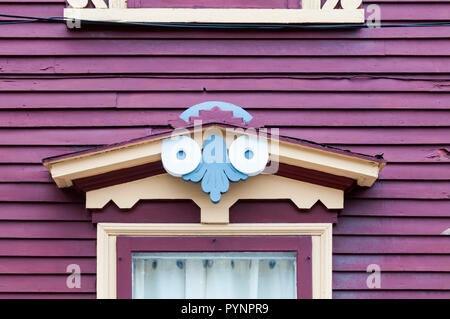 A carved wooden porch over a doorway on one of the colourful houses on Gower Street in St John's, Newfoundland. - Stock Photo