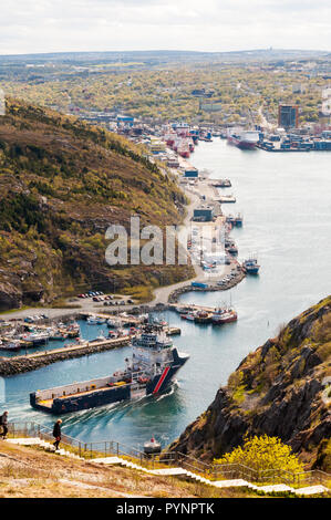 The offshore supply ship Siem Pilot passing though the Narrows to enter its home port of St John's, Newfoundland. - Stock Photo