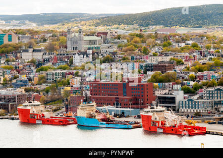 Offshore supply ships & tugs moored along the waterfront at St John's, Newfoundland. - Stock Photo