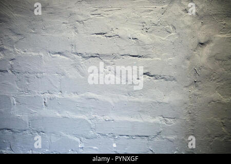 gray uneven textured brick wall background texture. - Stock Photo