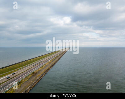 Aerial view of the flood protection dam Afsluitdijk - Stock Photo