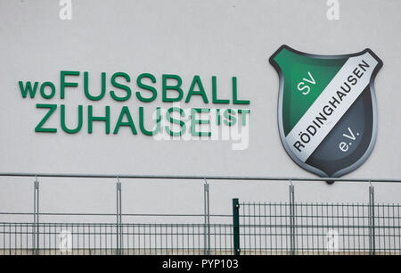 Roedinghausen, Germany. 29th Oct, 2018. 'Where football is at home' written on the facade of the Haecker Wiehenstadion. SV Roedinghausen faces off against FC Bayern Munich in the 2nd round of the soccer DFB Cup. The game takes place in Osnabrueck. SV Roedinghausen is currently playing in the football regional league West. The home stadium is in the East Westphalian district of Herford in North Rhine-Westphalia. Credit: Friso Gentsch/dpa/Alamy Live News - Stock Photo