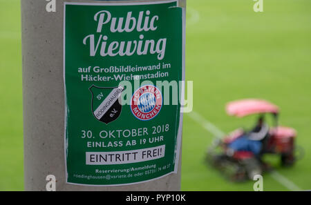 29 October 2018, North Rhine-Westphalia, Roedinghausen: 'Public Viewing' written on a poster in the Haecker Wiehenstadion. SV Roedinghausen faces off against FC Bayern Munich in the 2nd round of the soccer DFB Cup. The game takes place in Osnabrueck. SV Roedinghausen is currently playing in the football regional league West. The home stadium is in the East Westphalian district of Herford in North Rhine-Westphalia. Photo: Friso Gentsch/dpa - Stock Photo