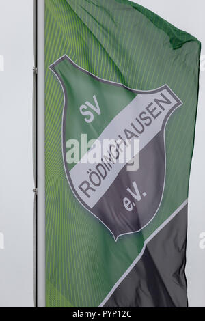 Roedinghausen, Germany. 29th Oct, 2018. The club flag of SV Roedinghausen e.V. blowing in the wind in front of the Haecker Wiehenstadion. SV Roedinghausen faces off against FC Bayern Munich in the 2nd round of the soccer DFB Cup. The game takes place in Osnabrueck. SV Roedinghausen is currently playing in the football regional league West. The home stadium is in the East Westphalian district of Herford in North Rhine-Westphalia. Credit: Friso Gentsch/dpa/Alamy Live News - Stock Photo