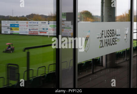 Roedinghausen, Germany. 29th Oct, 2018. The playing field reflected in the glass facade of the Haecker Wiehenstadion. SV Roedinghausen faces off against FC Bayern Munich in the 2nd round of the soccer DFB Cup. The game takes place in Osnabrueck. SV Roedinghausen is currently playing in the football regional league West. The home stadium is in the East Westphalian district of Herford in North Rhine-Westphalia. Credit: Friso Gentsch/dpa/Alamy Live News - Stock Photo