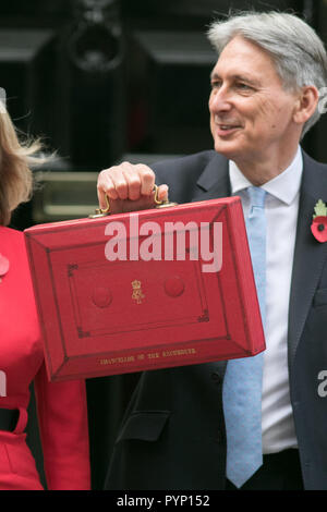 London UK. 29th October 2018. Chancellor of the Exchequer Philip Hammond leaves outside 11 Downing Street before going to Parliament to present the last Budget before Brexit  with promises to end austerity  and increase in public spending Credit: amer ghazzal/Alamy Live News - Stock Photo