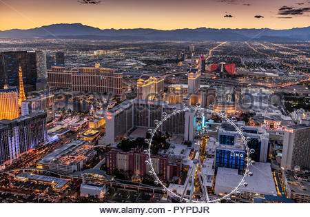 Aerial evening view of portion of Las Vegas Strip with High Roller in foreground - Stock Photo