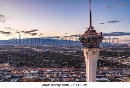 Aerial night close up view of the Stratosphere on the Las Vegas Strip. - Stock Photo