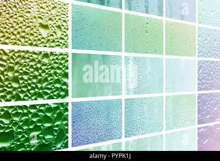 A collage of many different fragments of glass, decorated with rain drops from the condensate. Spring tones with green and blue colors - Stock Photo