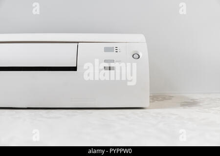 White air conditioner system on white wall in a room. - Stock Photo