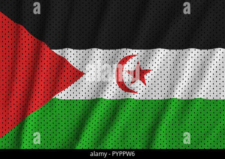 Western Sahara flag printed on a polyester nylon sportswear mesh fabric with some folds - Stock Photo