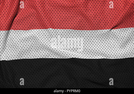 Yemen flag printed on a polyester nylon sportswear mesh fabric with some folds - Stock Photo