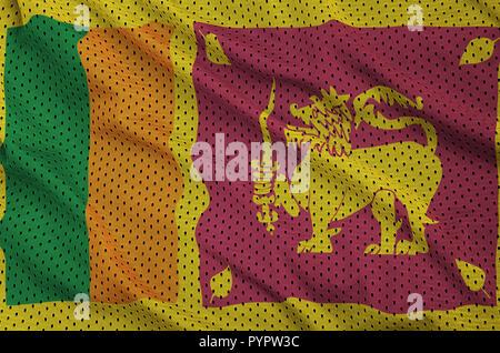 Sri Lanka flag printed on a polyester nylon sportswear mesh fabric with some folds - Stock Photo