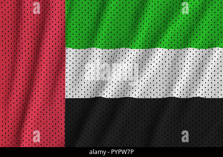 United Arab Emirates flag printed on a polyester nylon sportswear mesh fabric with some folds - Stock Photo