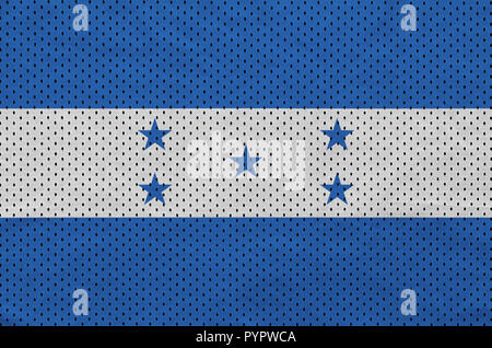 Honduras flag printed on a polyester nylon sportswear mesh fabric with some folds - Stock Photo