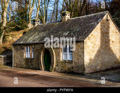 The old Blacksmiths Shop and Forge in Ford village on the Ford and Etal Estate in Northumberland. Note the horseshoe shaped door. - Stock Photo