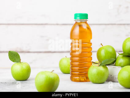 Bottle of fresh organic apple juice with healthy green apples in box on wooden background. Space for text - Stock Photo