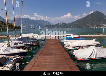 Boats moored on Lake Iseo in northern Italy - Stock Photo