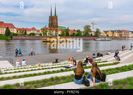 Cathedral Island Wroclaw, view of people looking across the River Oder to the Cathedral of St John The Baptist on Cathedral (Tumski) Island, Poland. - Stock Photo